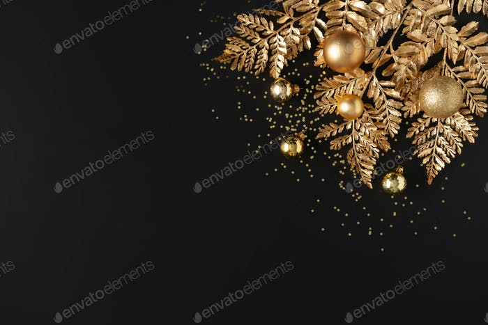 Christmas and New Year holiday background. Xmas greeting card. Golden Christmas decoration.