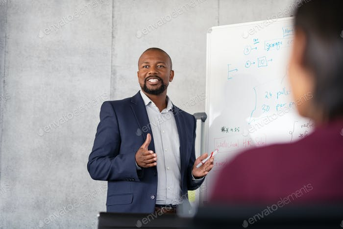 Mature african businessman training employees