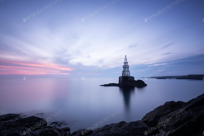 Achtopol`s lighthouse before sunrise (Bulgaria, Black sea)