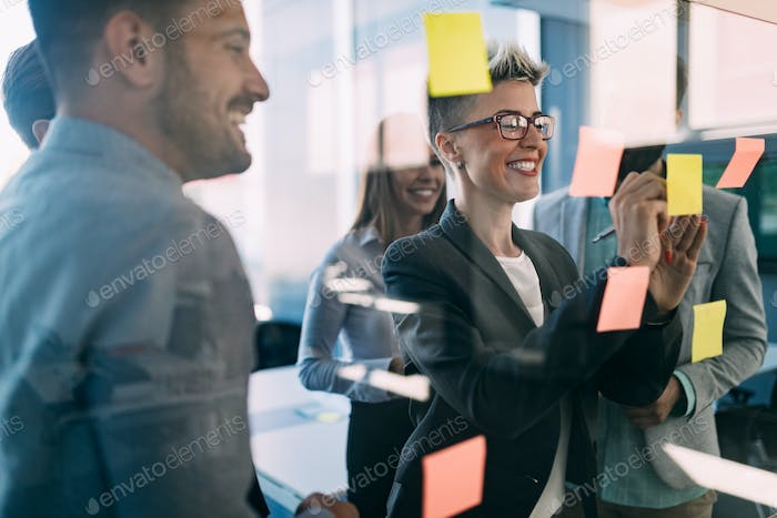 Group of coworkers working together on business project in modern office