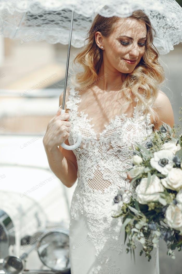 Elegant bride in a park