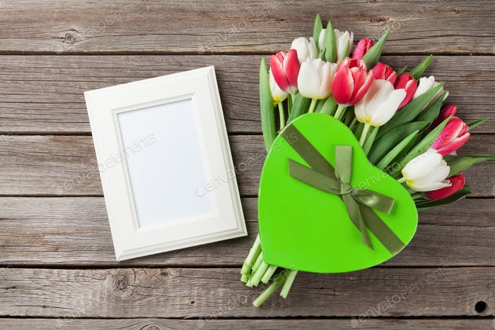 Fresh tulip flowers bouquet and photo frame