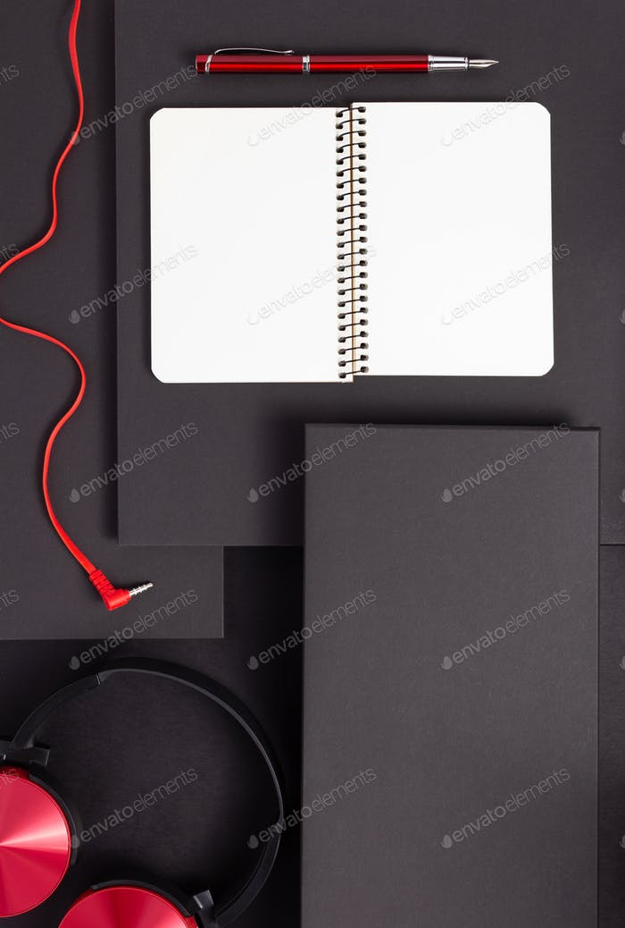 notebook with pen and headphones
