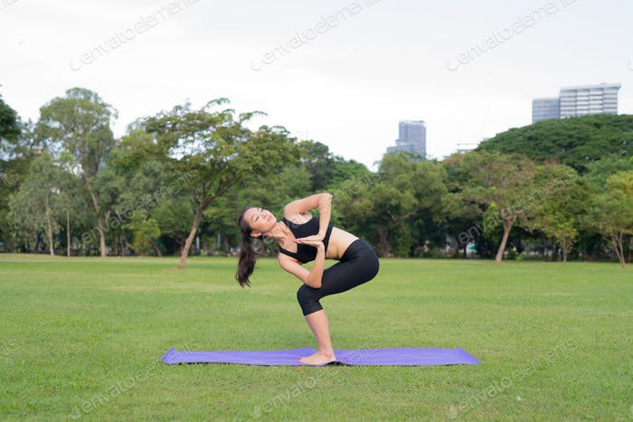 Woman Exercise Yoga In Park Ready For Healthy Lifestyle In Nature
