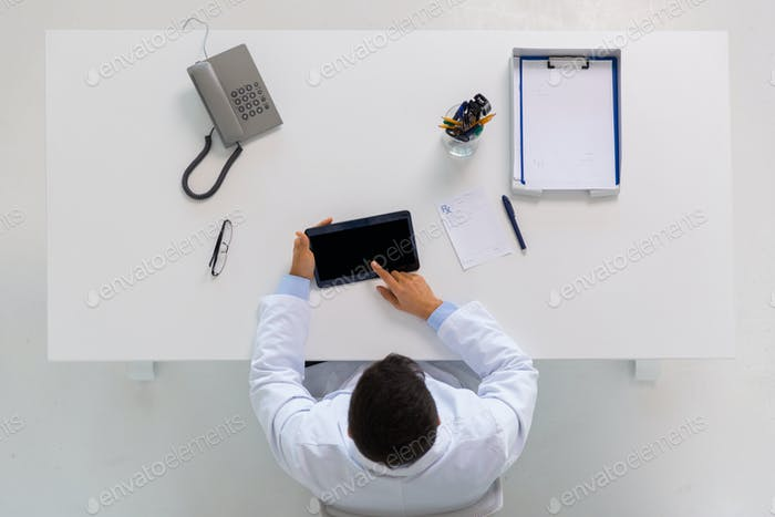 doctor with tablet pc and prescription at clinic
