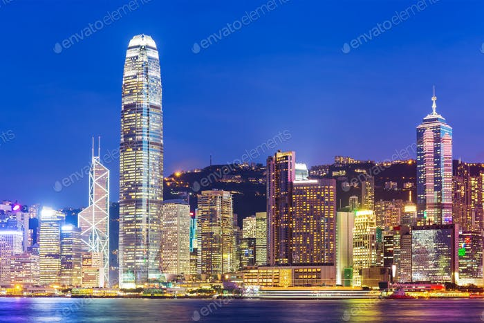 Hong Kong city skyline at night with Victoria Harbor and skyscraper