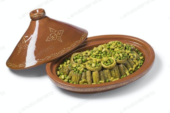 Marokkanische Tajine mit Cardoon, gefüllte Artischockenherzen mit grünen Erbsen und Bohnen