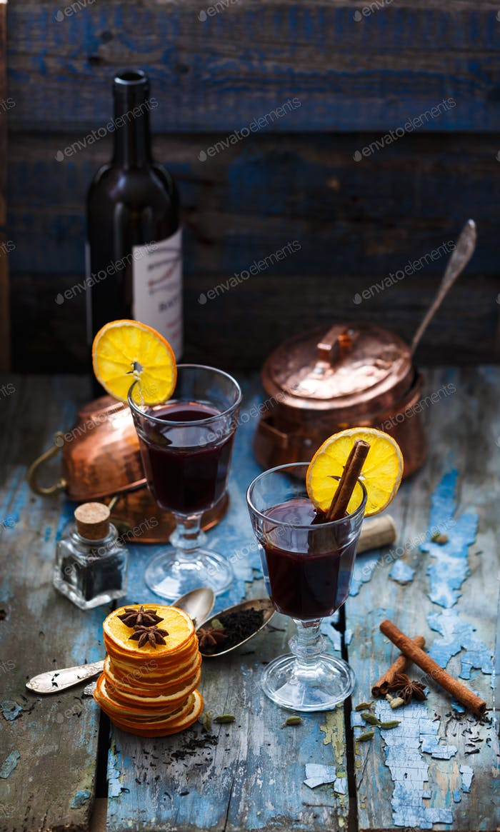 Mulled wine in glasses with ornge slices and spices
