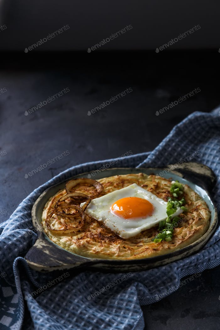 Thick mashed potatoes with sunny side egg, copy space