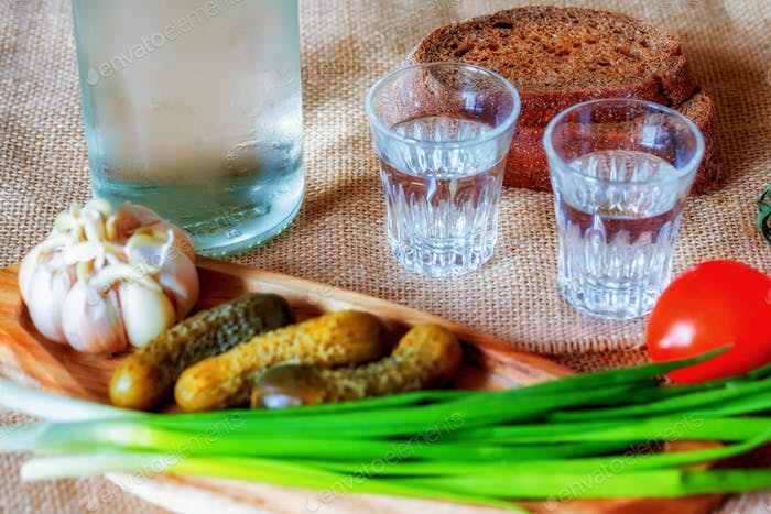 Vodka with lard, pickles and vegetables