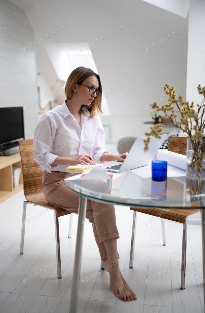 Female entrepreneur working on business project at home