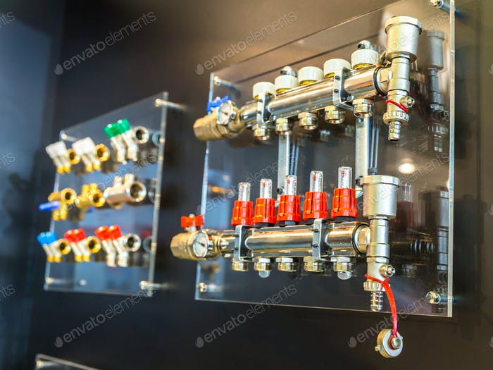 Floor heating collectors and valves, plumbing shop