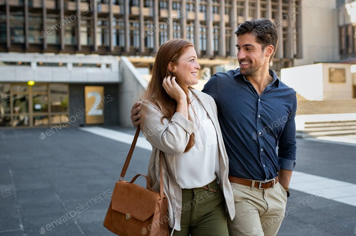 Mature couple in love walking at city centre