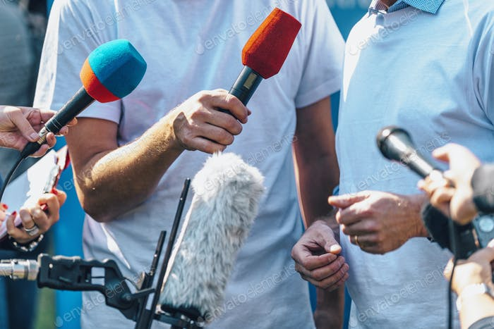 Media Event Outdoors. Journalists Interviewing Male Speaker