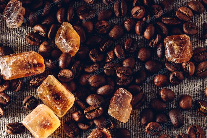 Roasted coffee beans and crystalline sugar