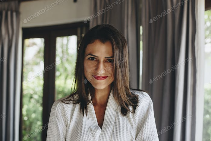 Cheerful woman in a bathrobe