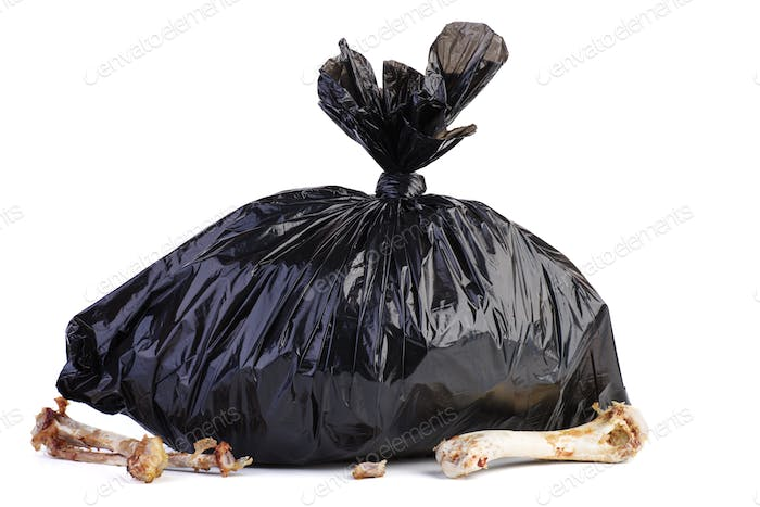 Big black plastic garbage bag and bones near