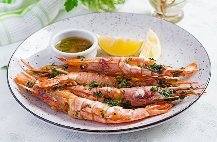 Grilled wild Argentinian red shrimps/prawns with parsley, oil, garlic and lemon. Delicious food.