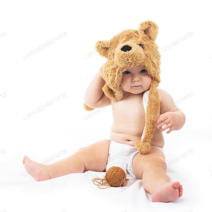 baby in bear cap