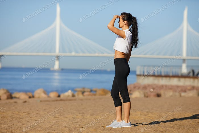 Attractive fit lady contemplating nature