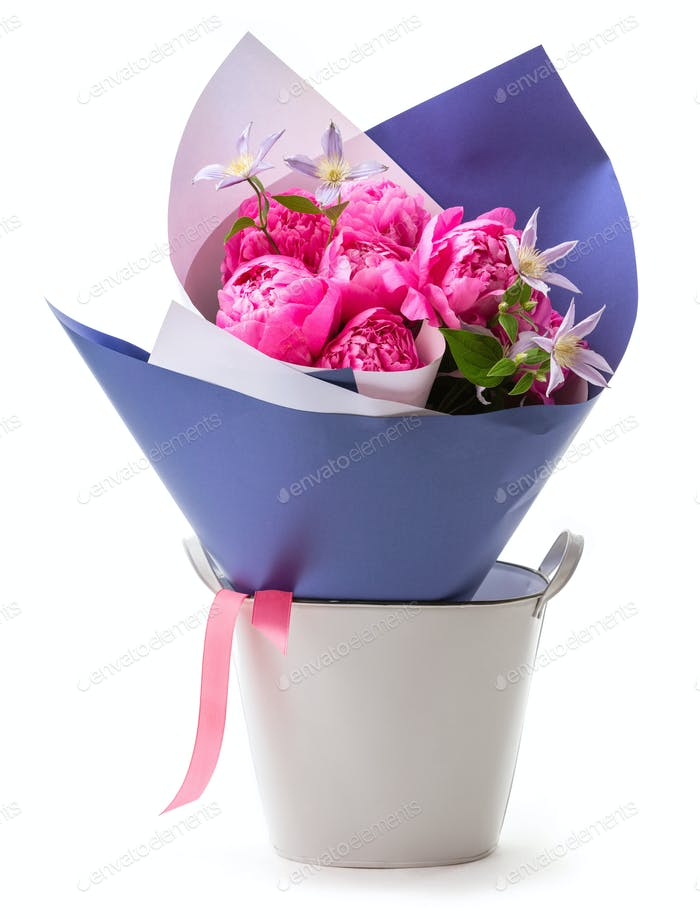 Bouquet of pink peonies wrapped in paper