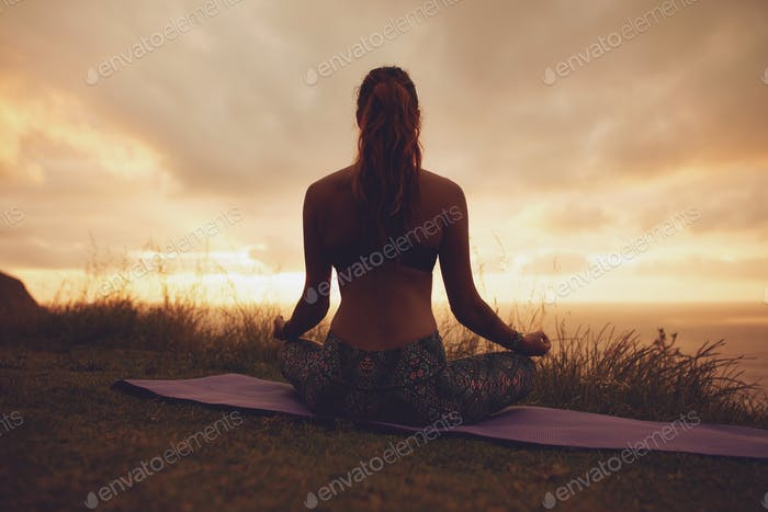 Thumbnail for Fitness woman in lotus yoga pose during sunset
