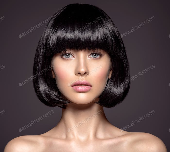 Woman with beauty short black hair - posing at studio.