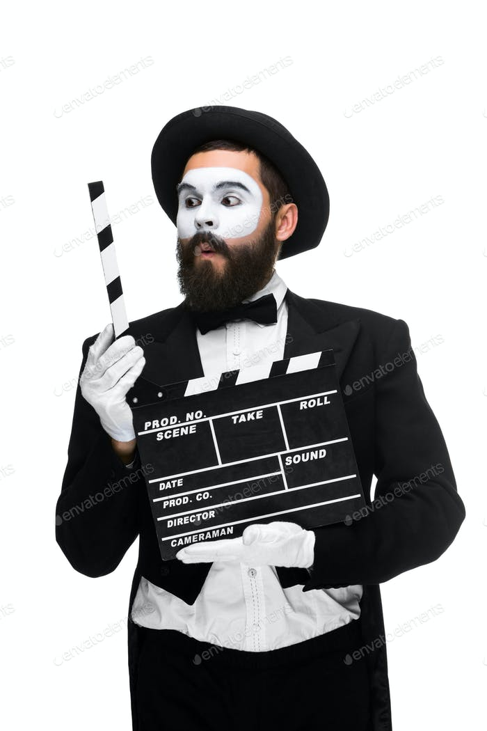Thumbnail for man in the image mime with movie board