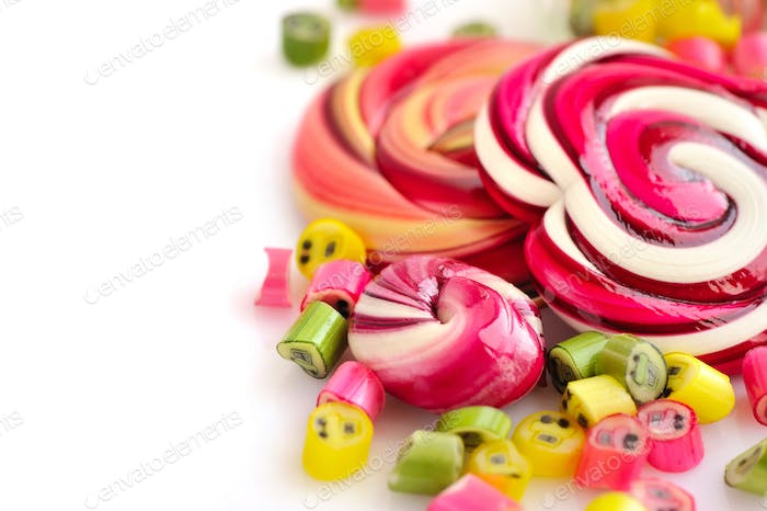 Colorful candies and lollipops on a white background