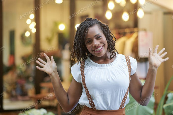 Excited young woman in shopping mall