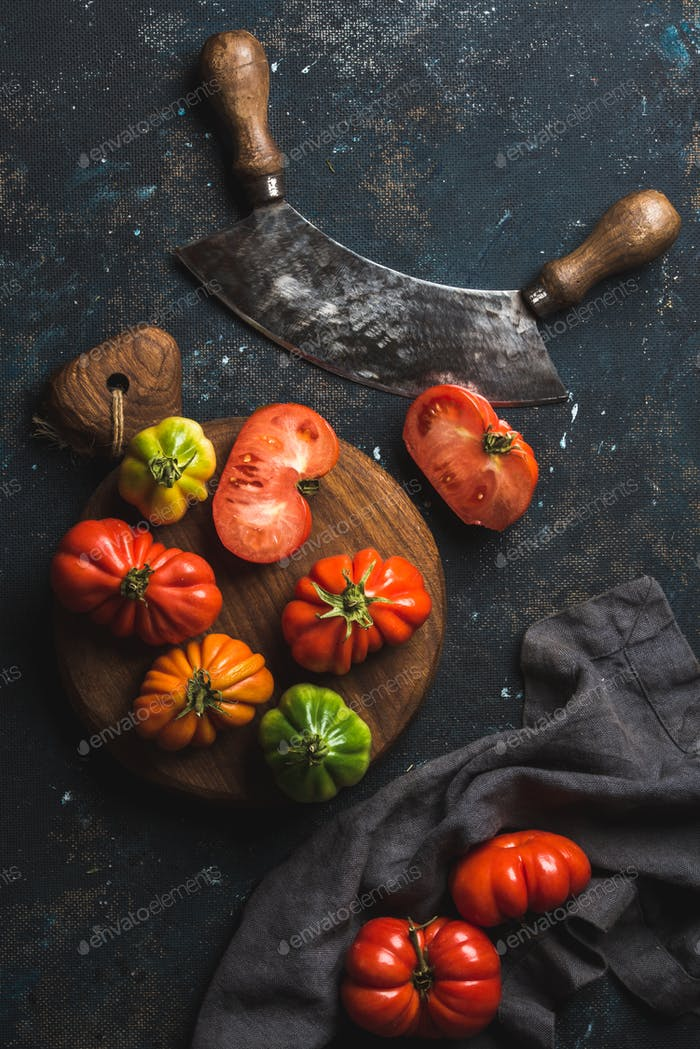 Fresh colorful ripe heirloom tomatoes on wooden board