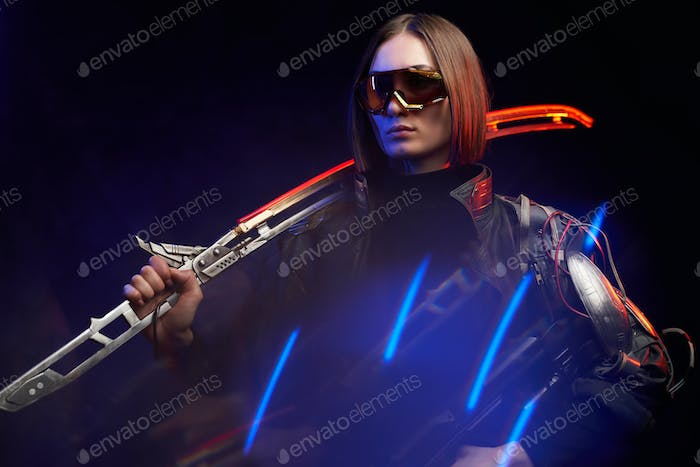 Female killer with sword and rifle in colourful and dark background
