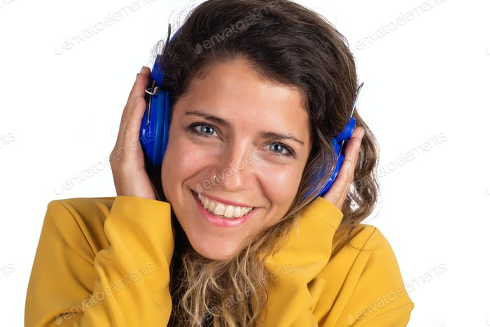Yoman listening to music with blue headphones.