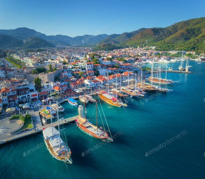 Aerial view of boats and beautiful architecture at sunset
