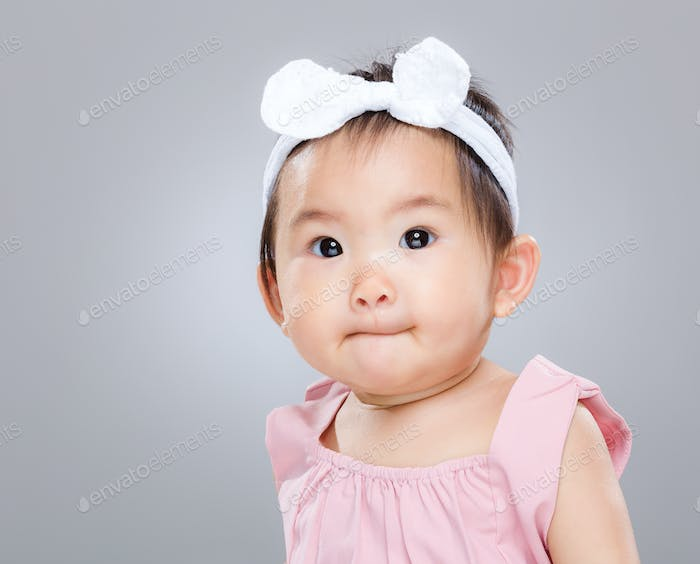 Cute baby close mouth