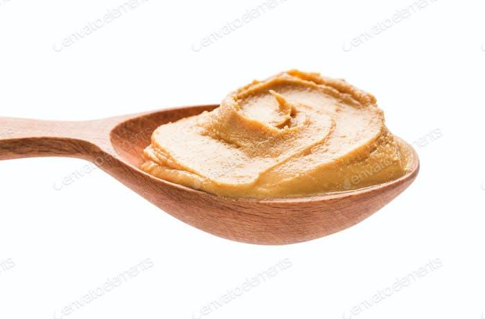 Spoon with peanut paste