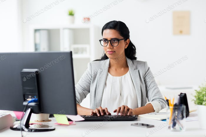 happy businesswoman with computer at office