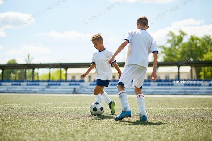 Boys Playing  Football Outdoors