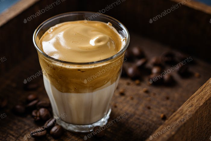 Dalgona coffee with whipped foam in cup