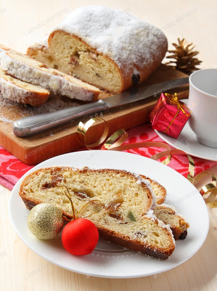 Sliced stollen with christmas decoration, a traditional German fruit cake