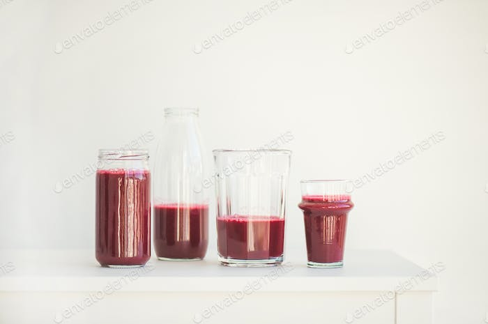 Fresh morning beetroot smoothie or juice in glasses, copy space