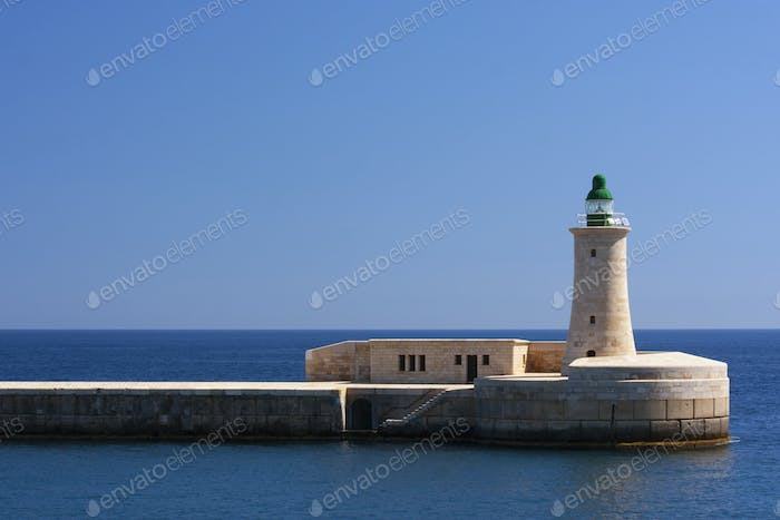 The lighthouse in Valetta in the harbour.