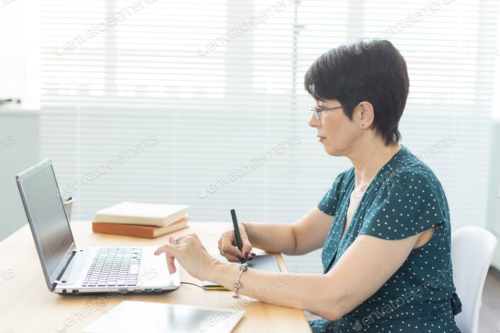 Office, graphic designer, digital - Middle age woman working at the office with laptop and digital