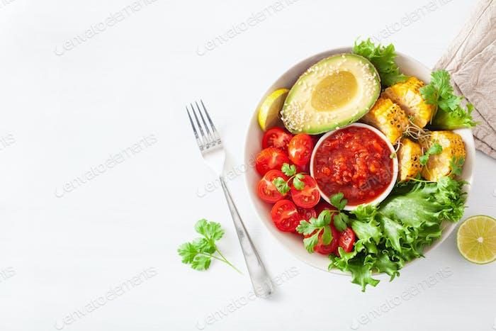 vegan buddha bowl. healthy lunch bowl with avocado, tomato, swee