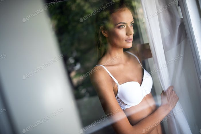 Portrait of beautiful sexy young woman with glamorous face