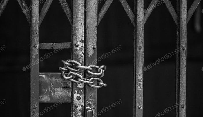 Closeup of chained sliding grille door