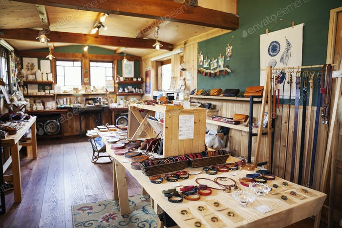 Interior view of a leather shop selling belts, bracelets and handbags.
