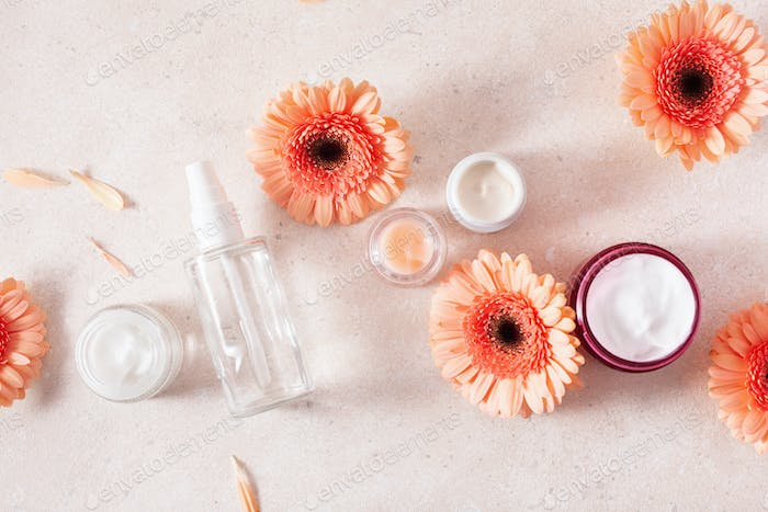 skincare products and daisy flowers. natural cosmetics for home spa treatment