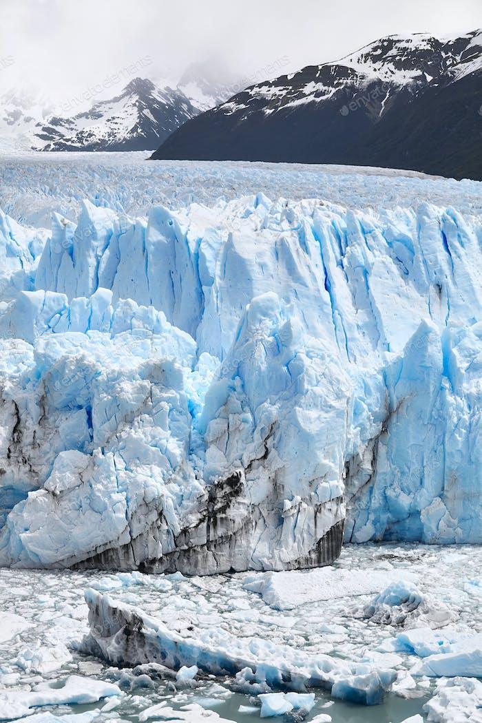 Ice calving from the terminus of the Perito Moreno Glacier in Patagonia, Argentina.