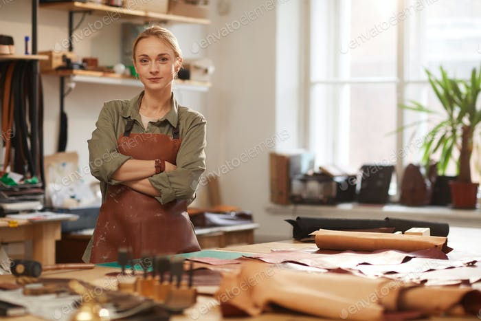Female Artisan In Leather Workshop